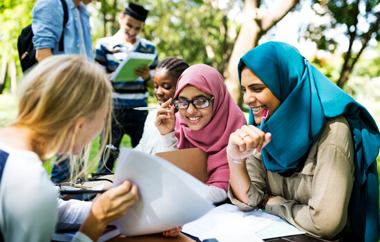 Diverse children studying outdoor